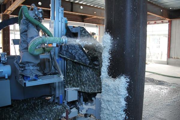 「耐火被覆吹付ロボット」によるロックウール・モルタル吹付作業